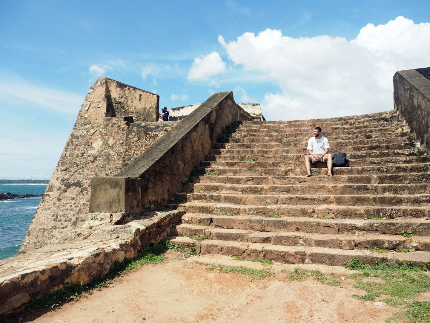 Boy sitting on steps of Galle Fort