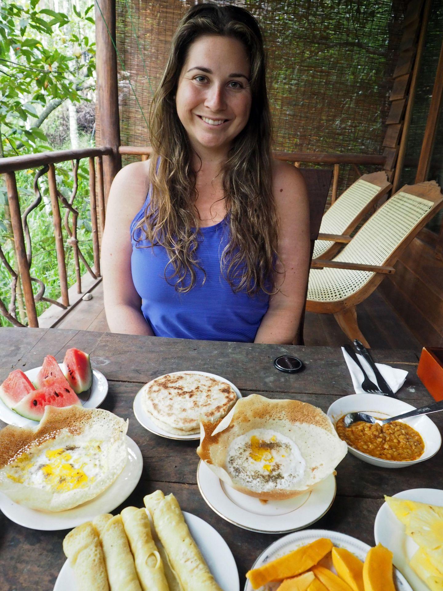 Girl eating breakfast at Ella Ecolodge