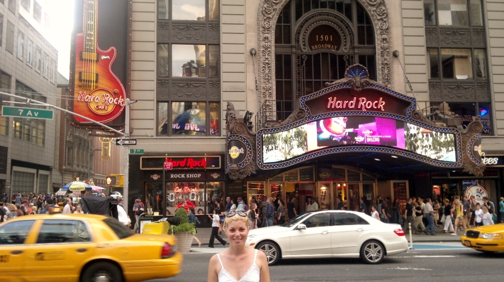 Girl in front of Hard Rock Cafe