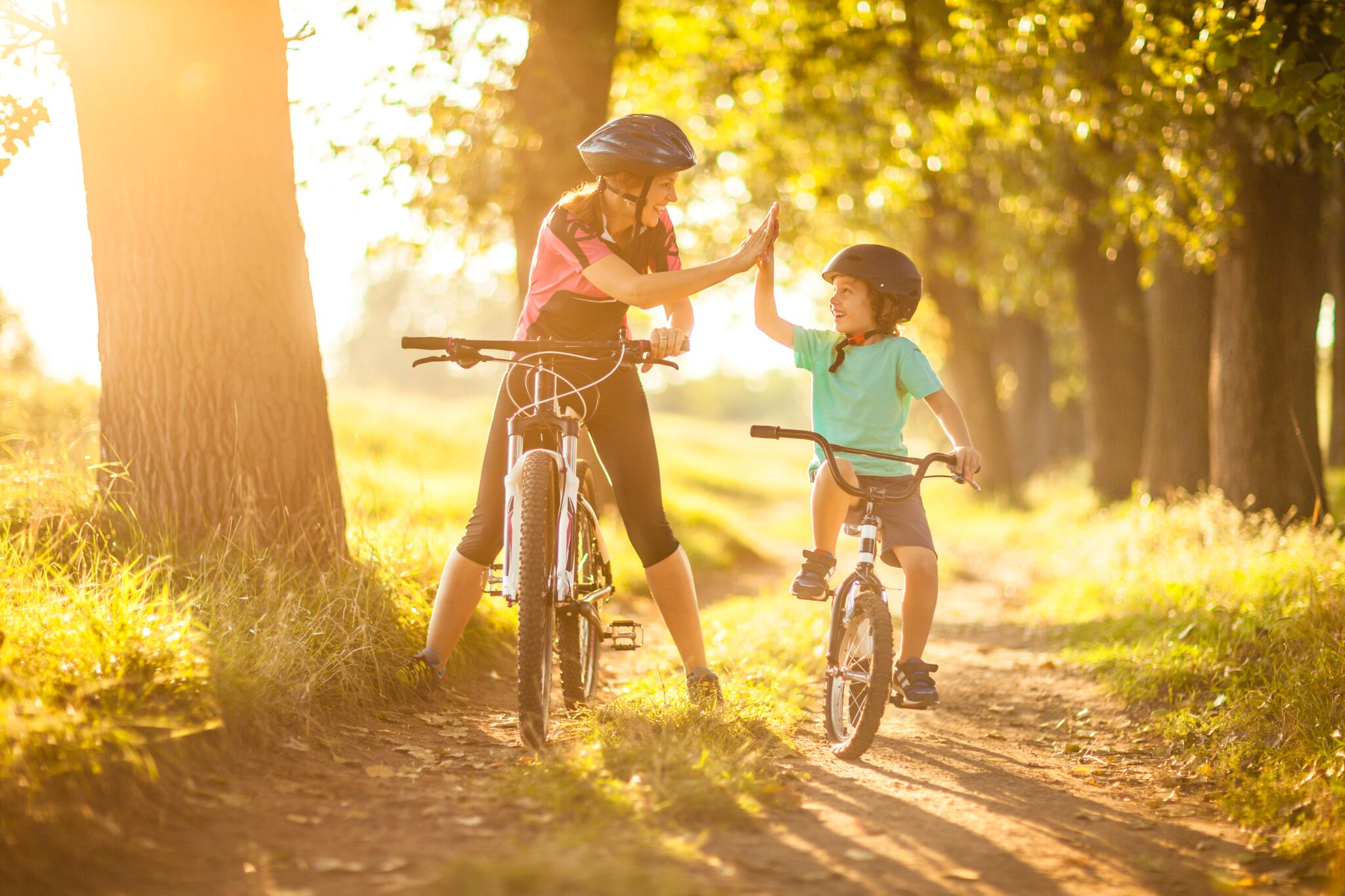 Mother and son cycling in countryside