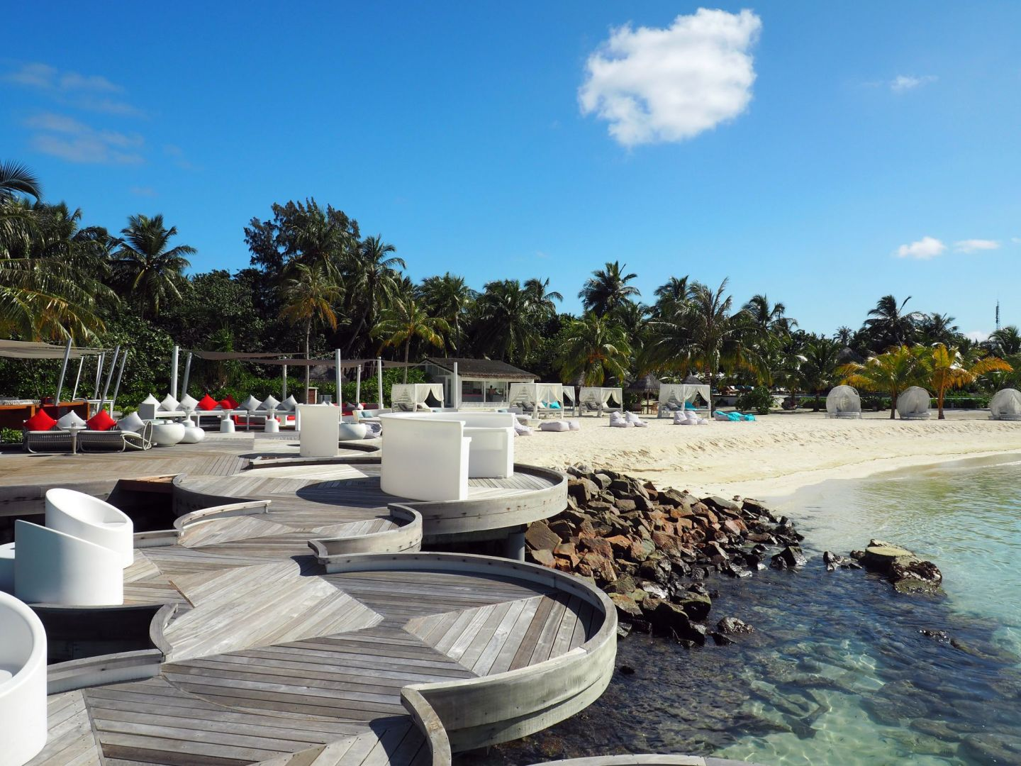 Outdoor seating at Beach Rouge LUX Maldives