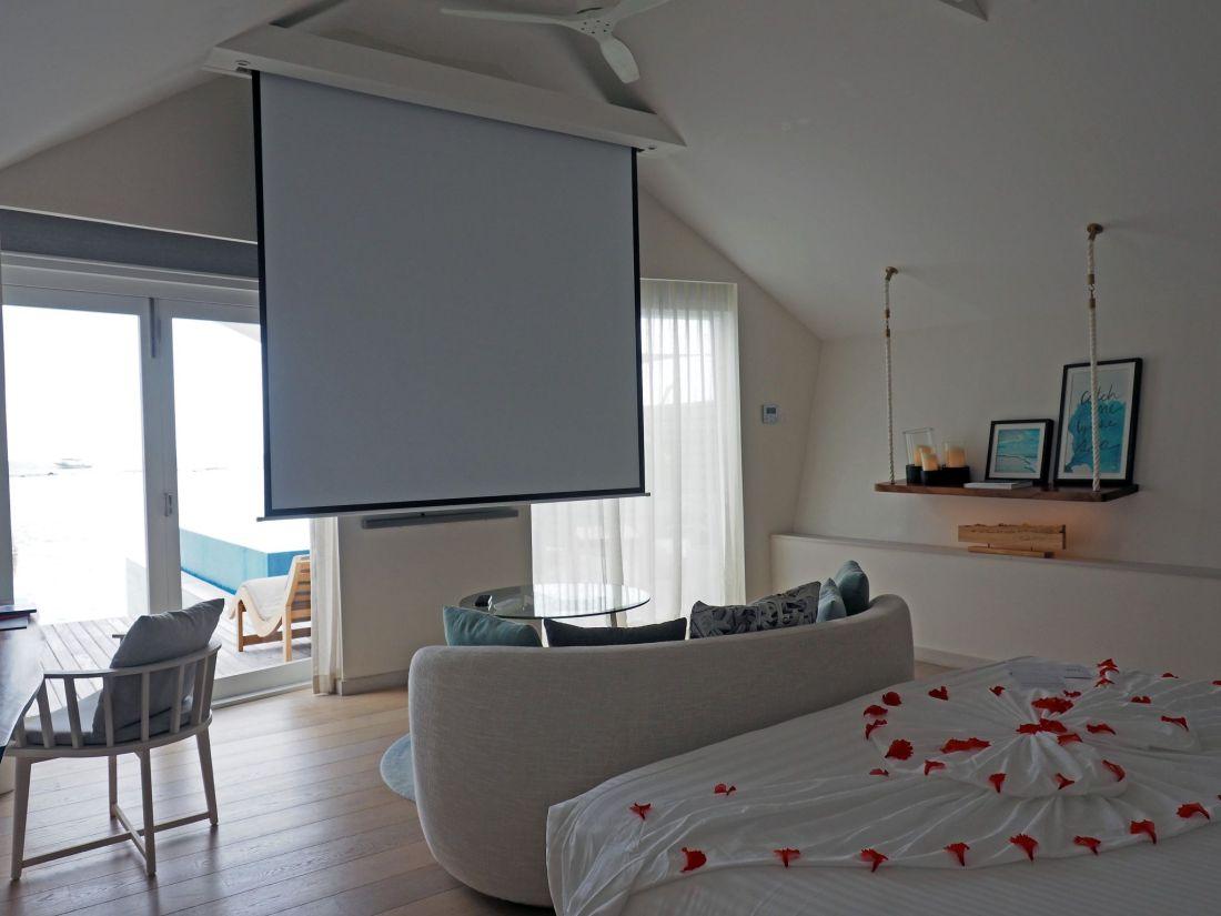 Pull down cinema screen water villa LUX Maldives