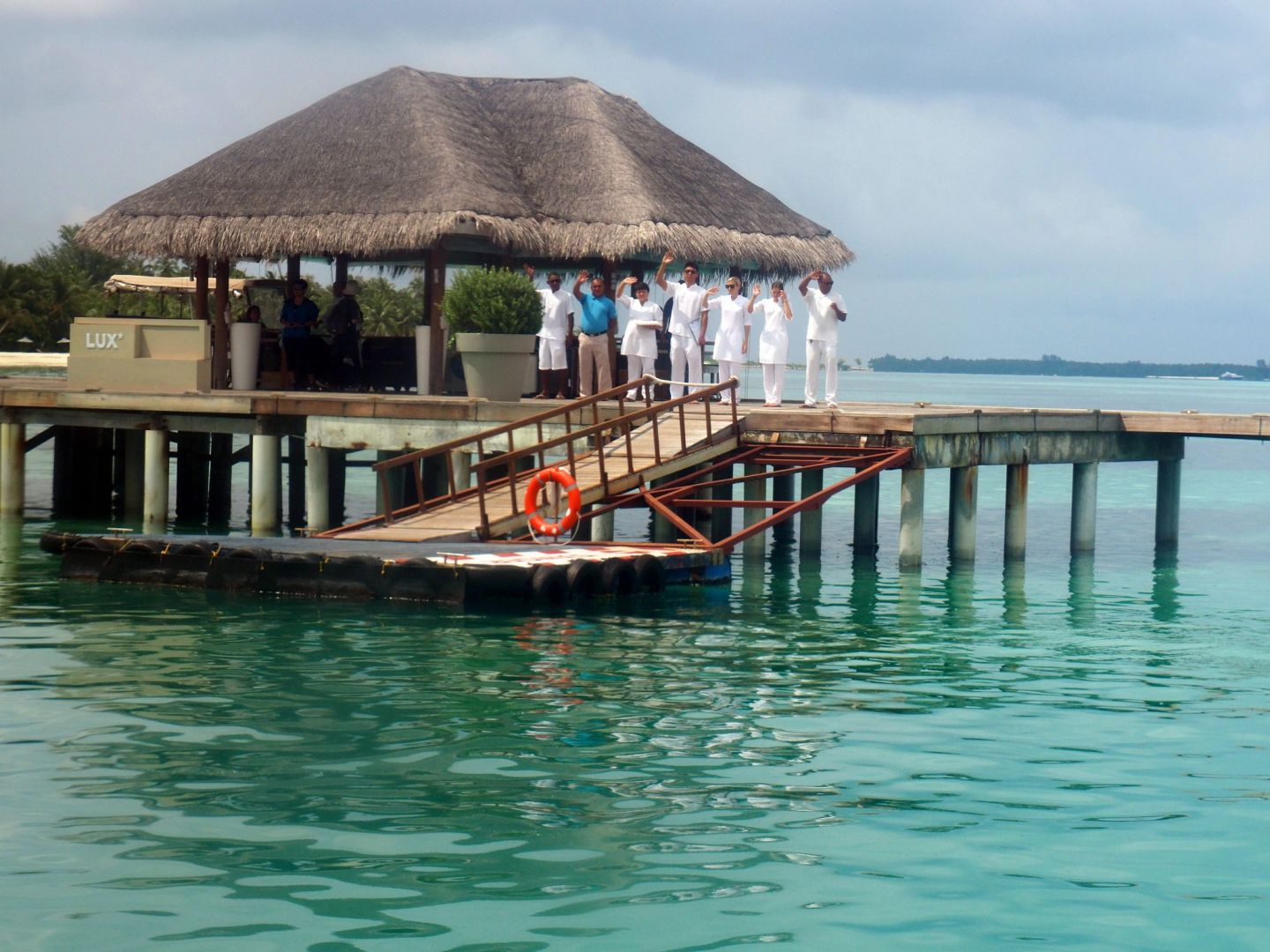 Staff greeting seaplane at South Ari Atoll