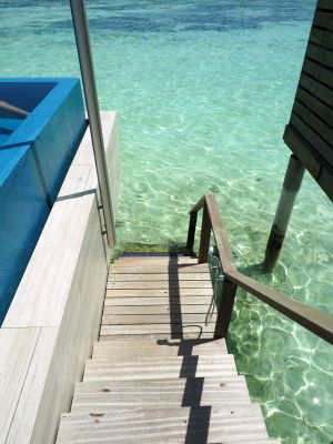 Stairs to water from overwater bungalow LUX Maldives