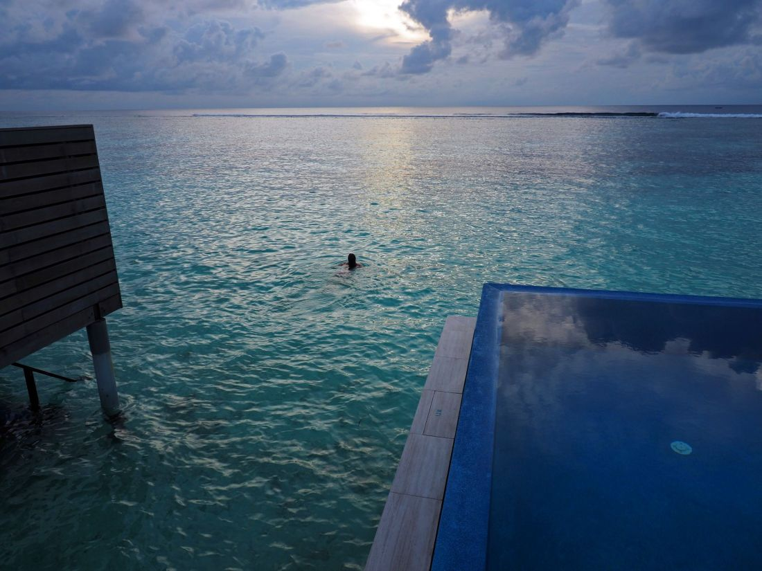 Swimming at dusk LUX Maldives