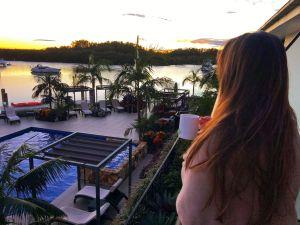Girl watching Sunrise from Sails Port Macquarie Balcony