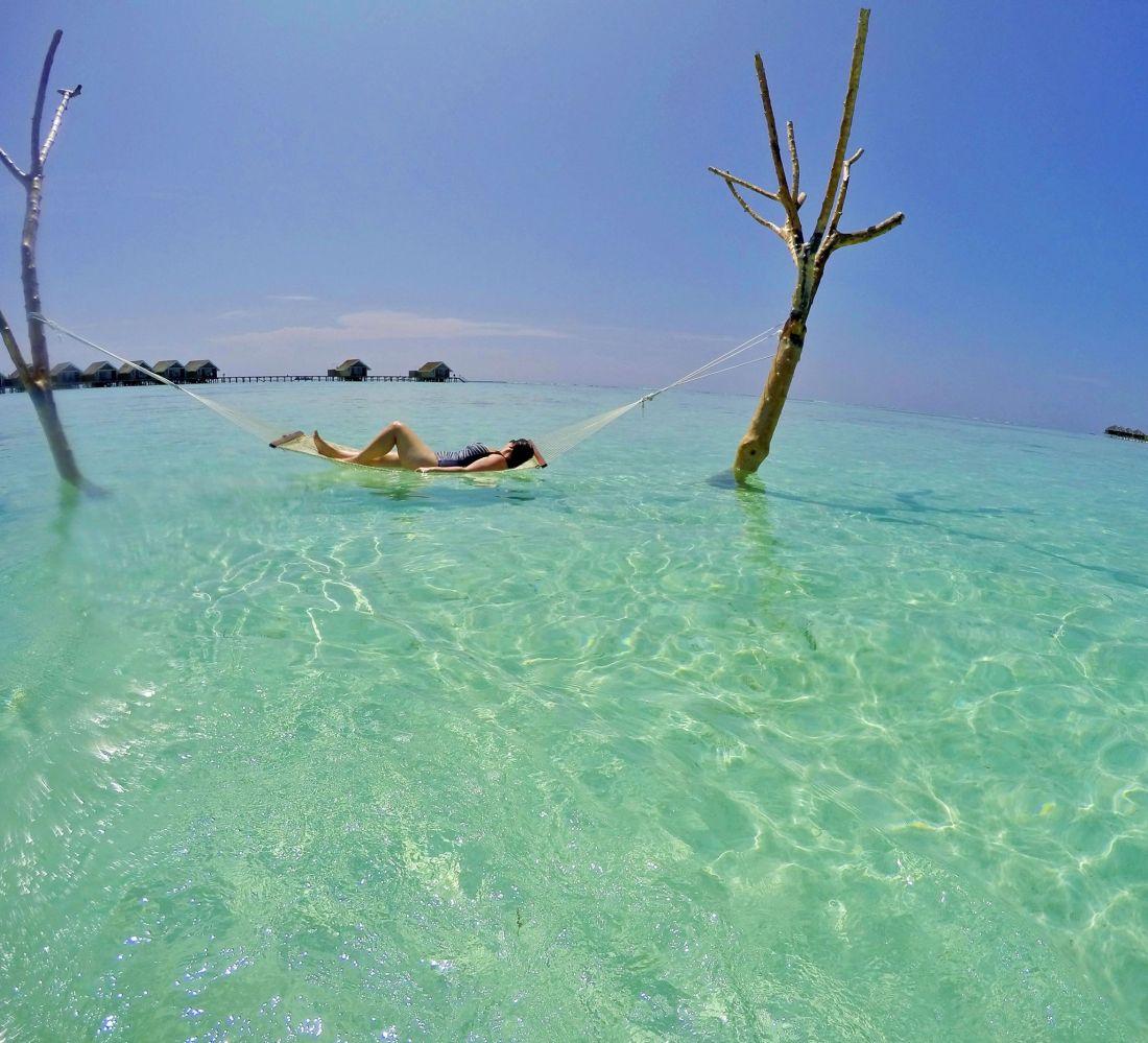 Simone in Hammock in water Maldives