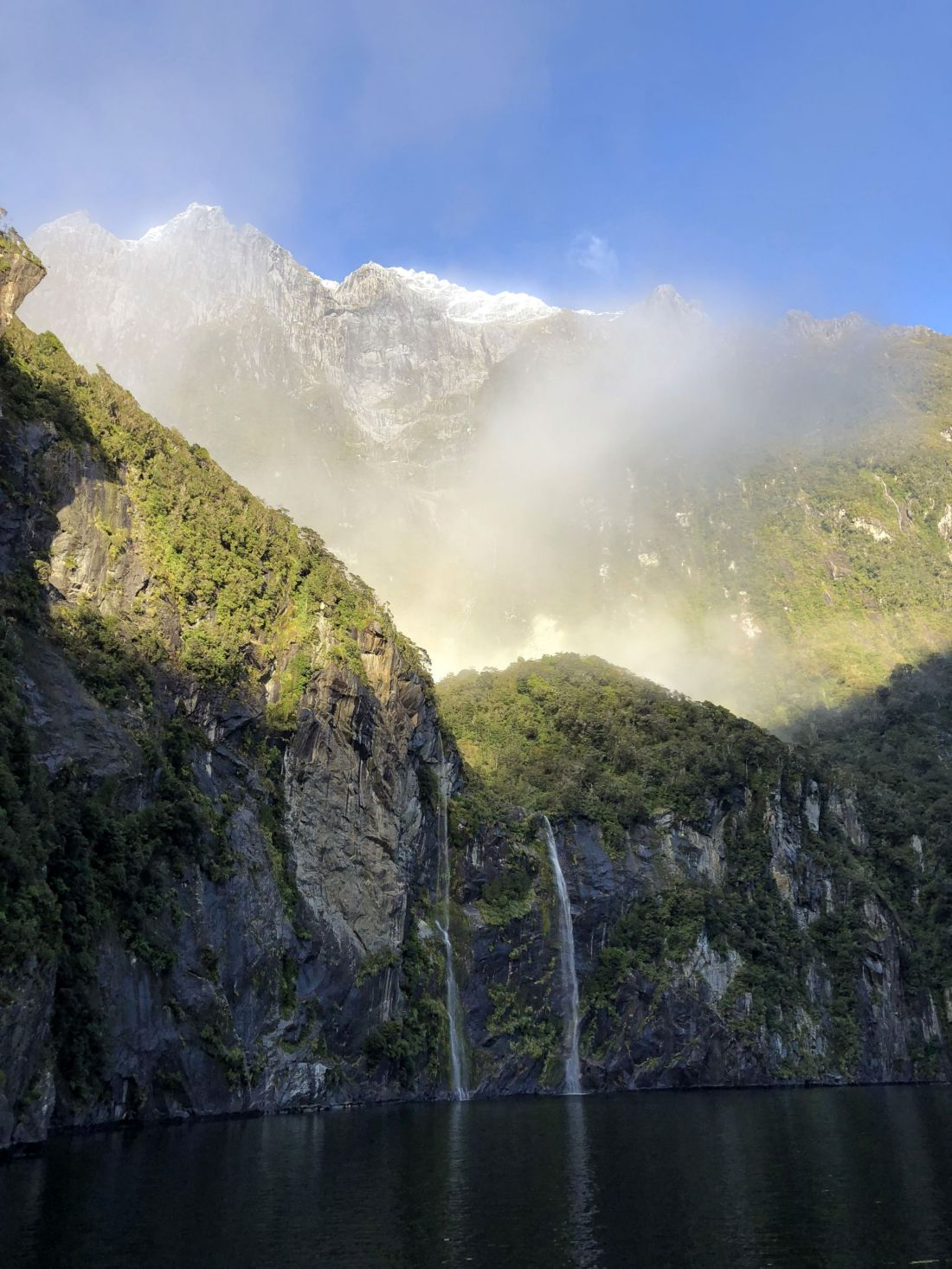 Sun and waterfalls Milford Sound