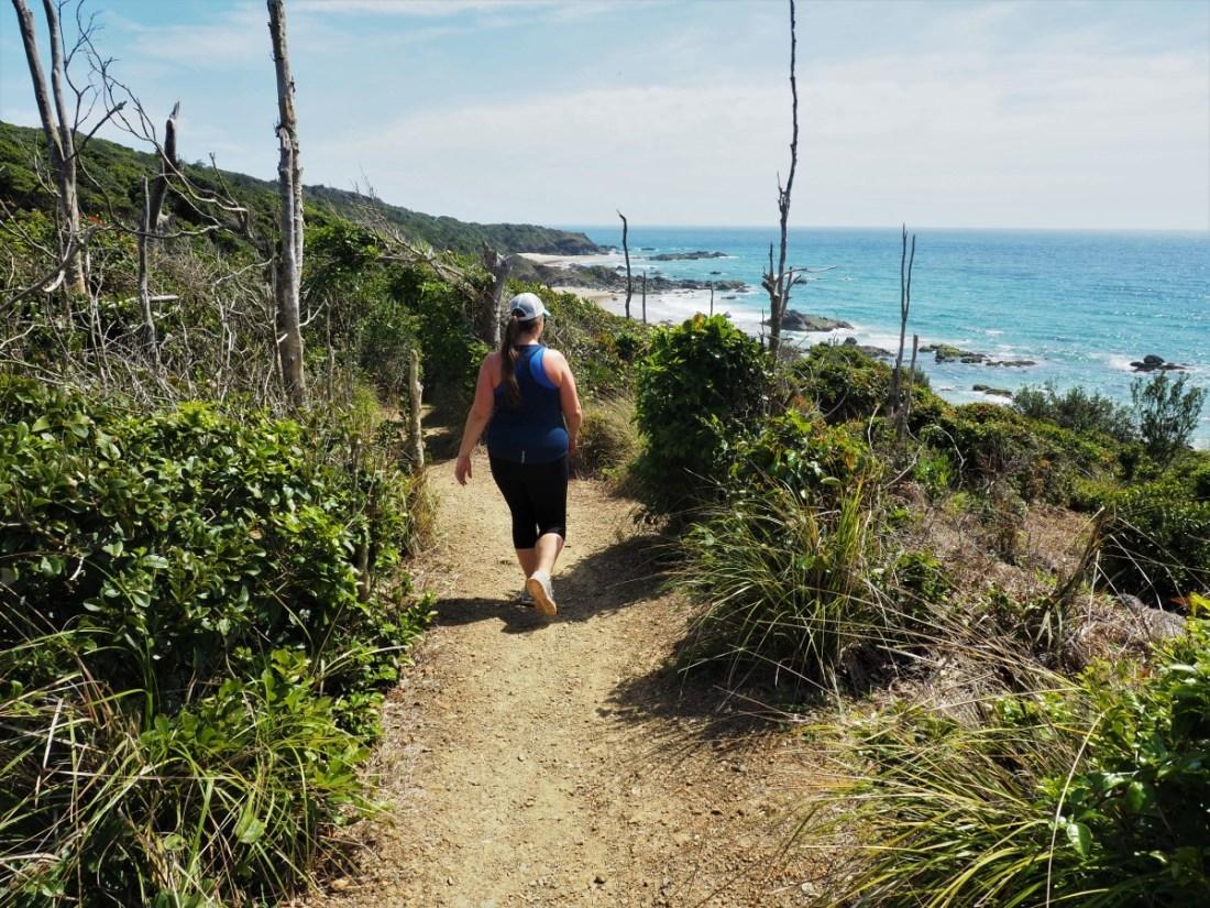 Simone walking to Miner's Beach Port Macquarie