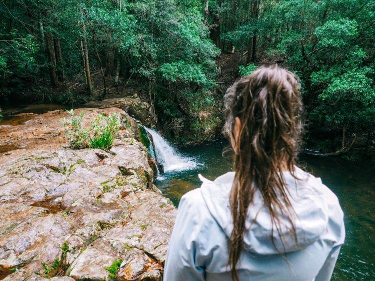 Girl looking at Waitui Falls