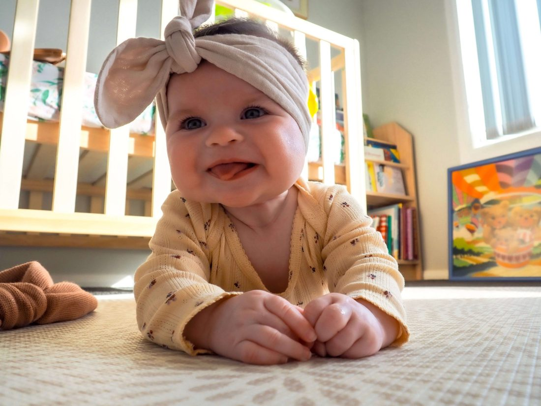 Smiling-baby-in-Elves-in-the-Wardrobe-Baby-Clothing