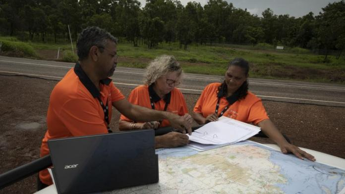 Remote census staff with map