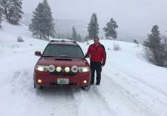 Paul and his Subaru on the road.