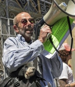 Ted Gullicksen, executive director of the San Francisco Tenants Union, leads a protest over Ellis Act evictions at apartments on Mason Street in July.
