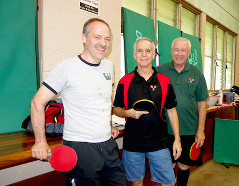 Will Shortz, left, spends the afternoon with North Hawaii residents Len Winkler and John Buck and others at the Waimea Community Center during his Hawaii ping pong tour. (LANDRY FULLER/SPECIAL TO WEST HAWAII TODAY)