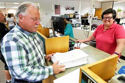 Sheriff Allman turns in thousands of signatures for Measure AG/AH to County Clerk Sue Ranochak at her Ukiah office