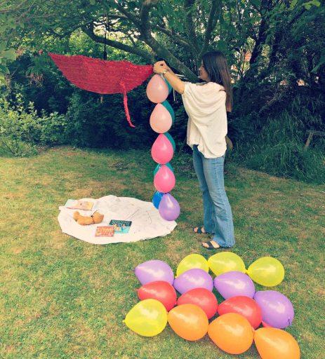 Ulla Lake making a garden party balloon den in a tree