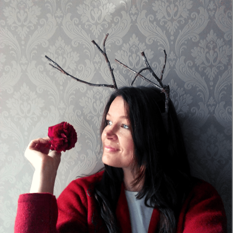 blogger ulla lake wearing an antlers headband made from twigs nature craft diy and a rose