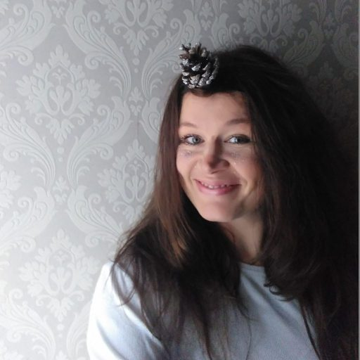 Ulla Lake wearing a unicorn headband made with pine cones an easy nature family craft idea from the awesome childhood project