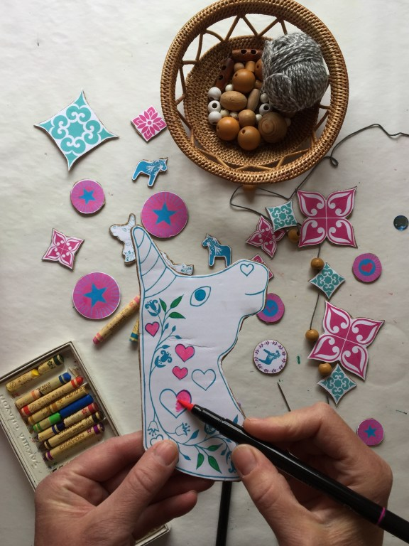 colouring in a unicorn free craft printable for a recycled cardboard junk and nature necklace
