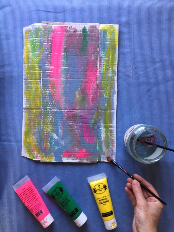 paint a colourful pattern on cardboard to make recycled cardboard nature necklaces with kids