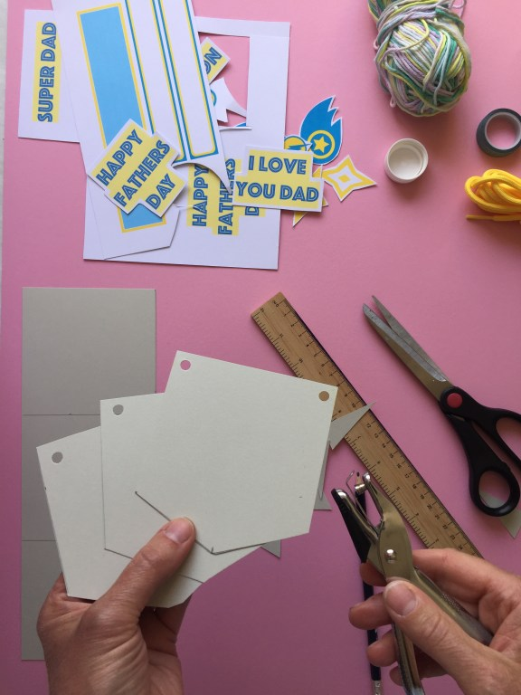 cut out your A4 card into six pieces, to create your superhero themed kids homemade fathers day bunting