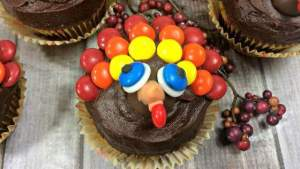 Thanksgiving Chocolate Cupcakes decorated like turkeys