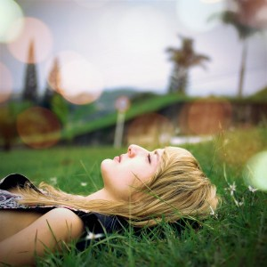meditate girl lying on grass
