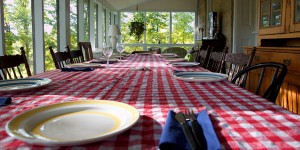 A long farm table setting for a large group