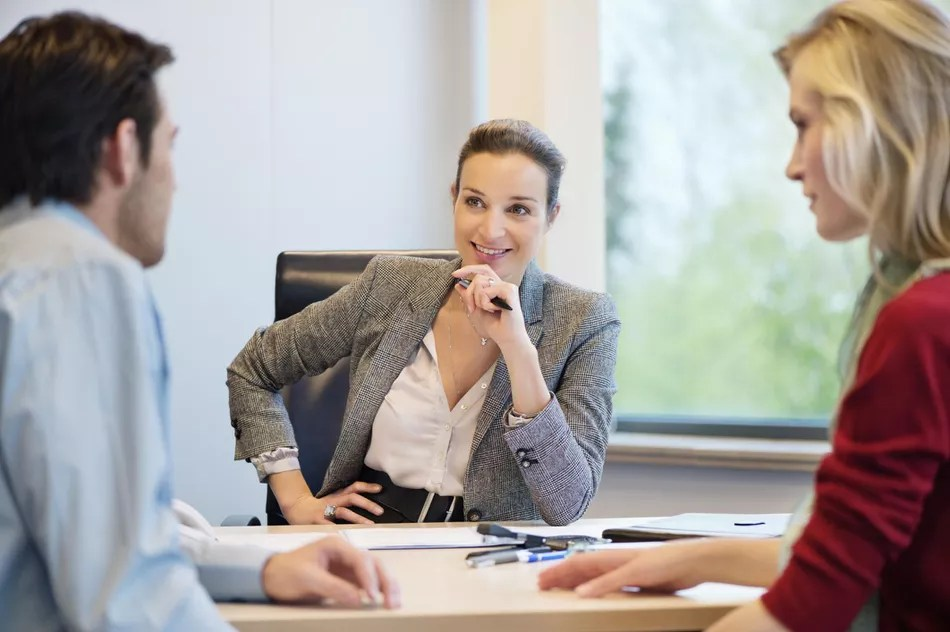 Business executive discussing with her clients