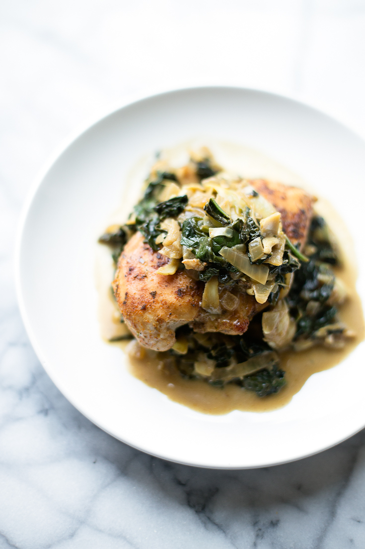 This Kale, Spinach, and Artichoke Chicken Skillet is the perfect 1-pan meal when you don't have a ton of time to cook, but want a hearty dinner. It is easy to make, flavorful and is paleo and Whole30-friendly.