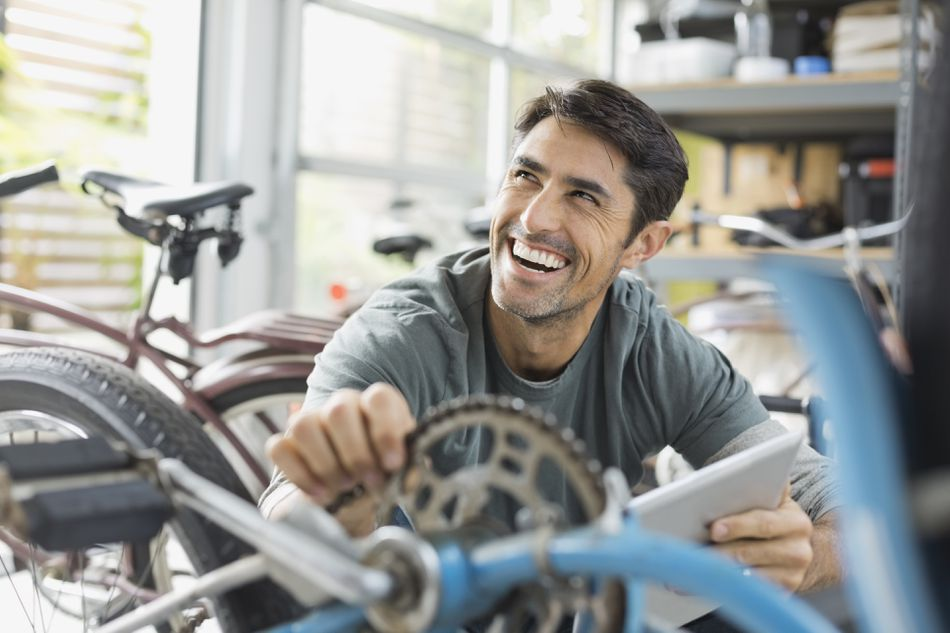 Happy worker in a bike shop