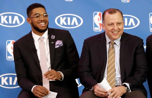 Minnesota Timberwolves' Karl-Anthony Towns, left, and new Timberwolves head coach Tom Thibodeau enjoy a laugh during a news conference announcing Town's selection as NBA basketball rookie of the year Monday, May 16, 2016, in Minneapolis. (AP Photo/Jim Mone)