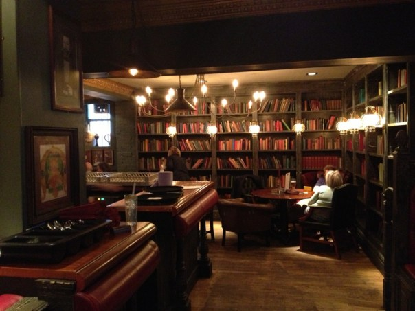 The books in the Queens Arms are actually real, not just wallpaper
