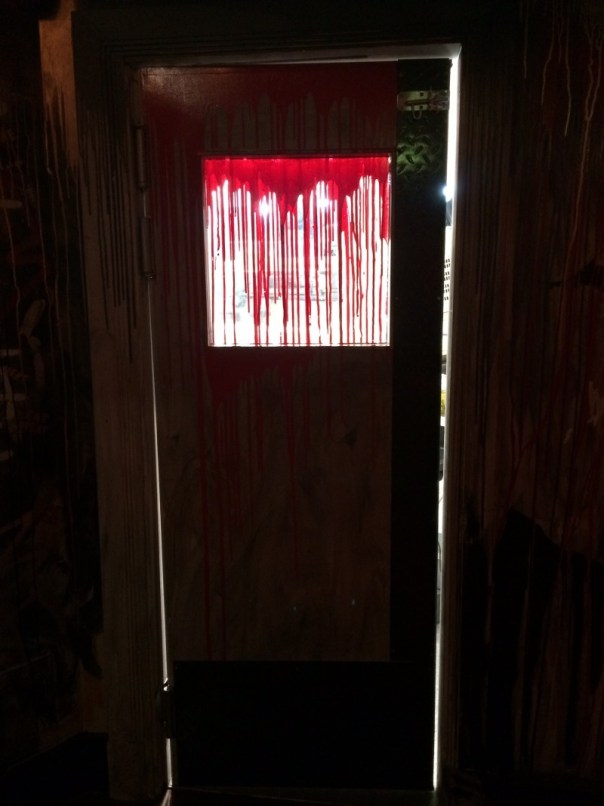 The door to the kitchen in The Boozy Cow hints at an ongoing bloodbath