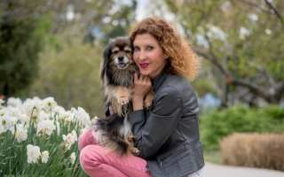 Board Certified Canine Acupressurist Alexandra Bennett, holding long haired beautiful dog, Tashi Bennett