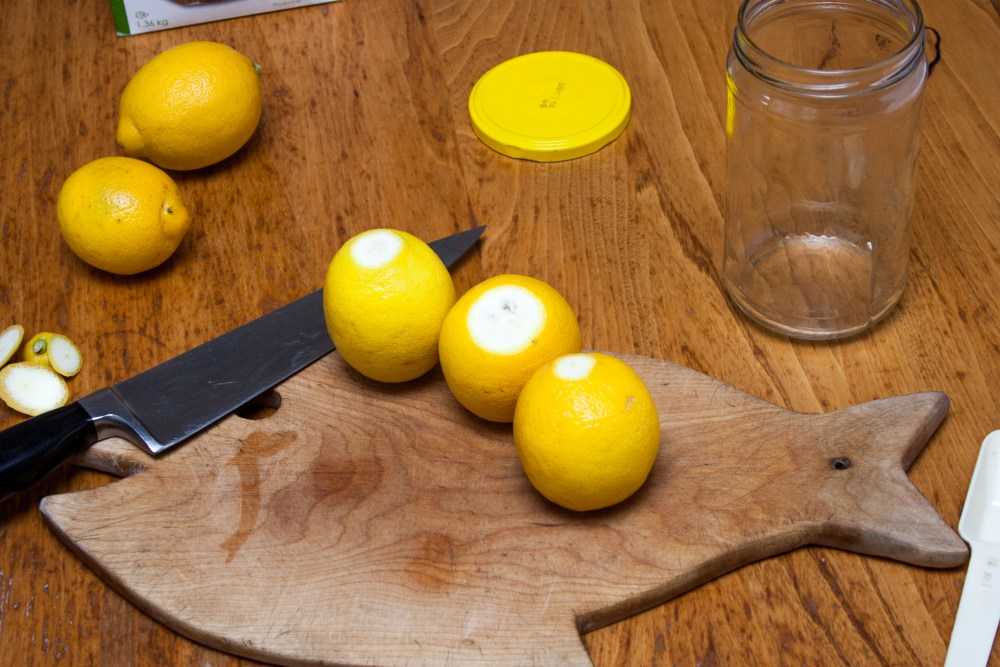 A photo of lemons on a cutting board.