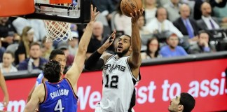 LaMarcus Aldridge's 38 points led San Antonio to a 124-92 victory in Game 1