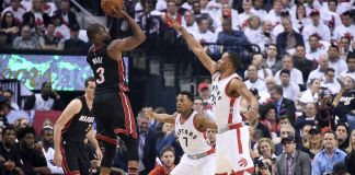 Wade powers Miami to an OT win over the Raptors