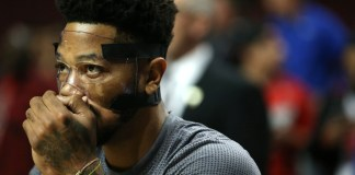 Oct. 27, 2015 - Chicago, IL, USA - The Chicago Bulls' Derrick Rose wears his protective mask while blowing on his hands before warming up for the season opener against the Cleveland Cavaliers at the United Center in Chicago on Tuesday, Oct. 27, 2015. (Photo by Chicago Tribune/Zuma Press/Icon Sportswire)