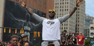 June 22, 2016 - Cleveland, Ohio, U.S. - The Cleveland Cavaliers' LEBRON JAMES celebrates along Huron Road in Cleveland during the team's NBA Championship celebration. Approximately 1.3 million people packed downtown along the 1.3-mile parade as the city celebrated its first major professional sports title since 1964 (Phil Masturzo/Zuma Press/Icon Sportswire)