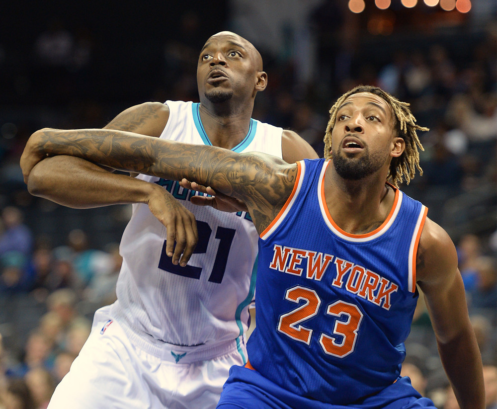 Oct. 17, 2015 - Charlotte, NC, USA - The Charlotte Hornets' Damien Wilkins (21) and the New York Knicks' Derrick Williams (23) battle for position in the paint during the first quarter of preseason action on Saturday, Oct. 17, 2015, at Time Warner Cable Arena in Charlotte, N.C. (Photo by Charlotte Observer/Zuma Press/Icon Sportswire)