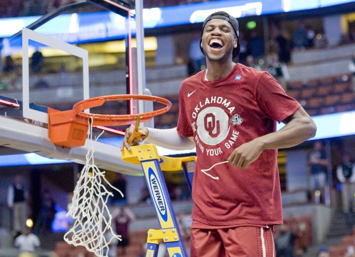 March 26, 2016 - Anaheim, CA, USA - Oklahoma guard Buddy Hield lets out a yell after cutting a string off the basket. The Oklahoma Sooners won the NCAA West Regional Championship over Oregon on Saturday. (Photo by Paul Rodriguez/Zuma Press/Icon Sportswire)