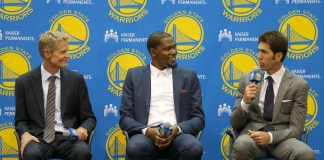 July 07, 2016 Oakland, CA: New Golden State Warriors forward Kevin Durant is introduced after signing a two-year, $54.3 million contract during a press conference at the team's practice facility in Oakland, CA. Coach Steve Kerr is on the left and General Manager Bob Myers on the right. (Photo by Daniel Gluskoter/Icon Sportswire)