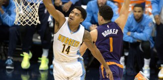 March 10, 2016 - Denver, Colorado, U.S - Nuggets guard Gary Harris (14) goes in for a dunk against Suns guard Devin Booker (1) during the second half at the Pepsi Center Thursday evening. The Nuggets beat the Suns 116-98 (Hector Acevedo/Zuma Press/Icon Sportswire)