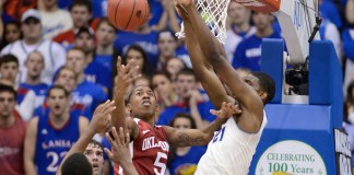 Feb. 24, 2014 - Lawrence, KS, USA - Oklahoma Sooners' Je'lon Hornbeck loses control of the ball while being defended by Kansas Jayhawks' Joel Embiid during the first half at Allen Fieldhouse in Lawrence, Kan., on Monday, Feb. 24, 2014. (Rich Sugg/Zuma Press/Icon Sportswire)