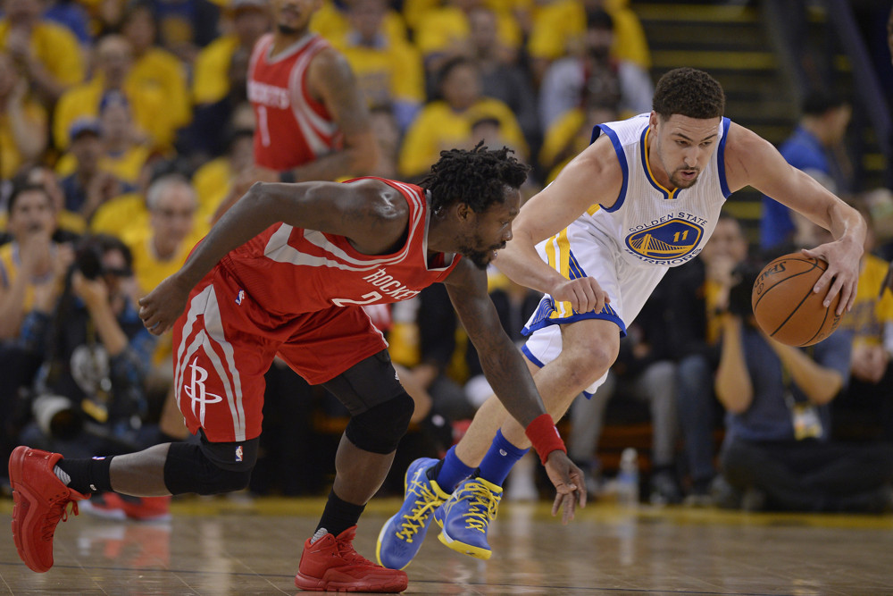 April 27, 2016 - Oakland, CA, USA - Golden State Warriors' Klay Thompson (11) steals the ball from Houston Rockets' Patrick Beverley (2) during the first quarter on Wednesday, April 27, 2016, at Oracle Arena. (Jose Carlos Fajardo/Zuma Press/Icon Sportswire)