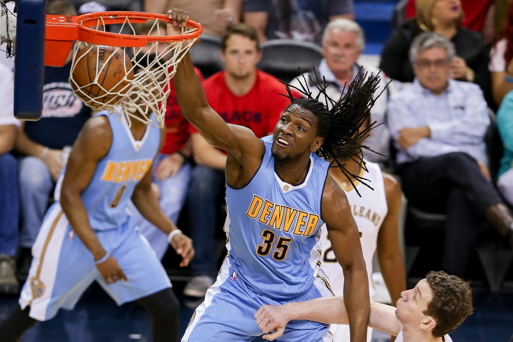 March 31, 2016: Kenneth Faried (35) drives to the basket against Omer Asik (3) during a game between the Denver Nuggets and the New Orleans Pelicans at the Smoothie King Center in New Orleans, LA. (Stephen Lew/Icon Sportswire)