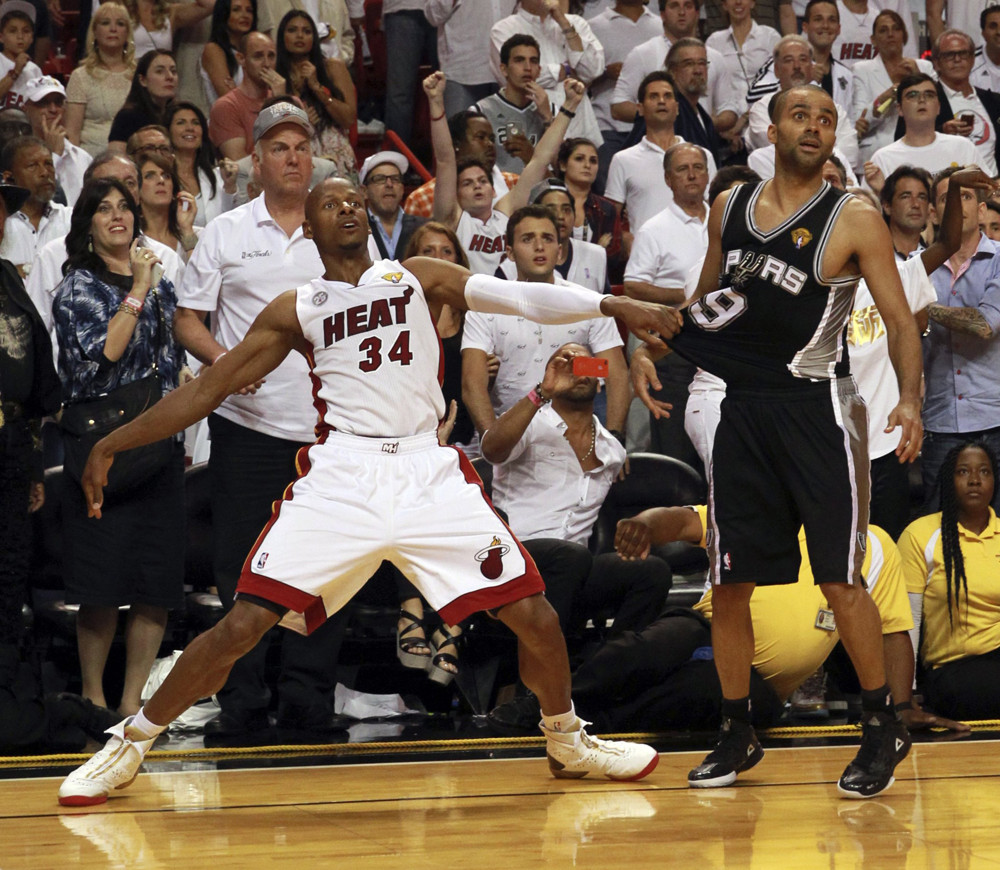 June 18, 2013 - Miami, FL, USA - The Miami Heat's Ray Allen (34) watches his 3-pointer fall in the final seconds of the fourth quarter as he holds the San Antonio Spurs' Tony Parker in Game 6 of the NBA Finals on Tuesday, June 18, 2013, at the AmericanAirlines Arena in Miami, Florida. Miami won, 103-100, in overtime to force a Game 7. (Zuma Press/Icon Sportswire)
