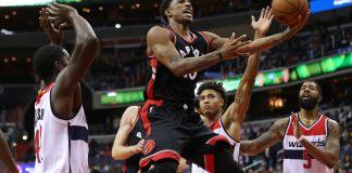 Nov 2, 2016; Washington, DC, USA; Toronto Raptors guard DeMar DeRozan (10) is fouled while shooting the ball by Washington Wizards forward Kelly Oubre Jr. (12) in the first quarter at Verizon Center. Mandatory Credit: Geoff Burke-USA TODAY Sports